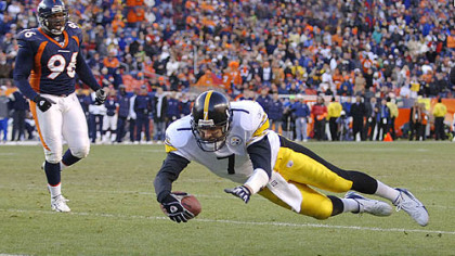 Roethlisberger dives into the end zone for a touchdown in the playoff victory over the Denver Broncos. (Jan. 20, 2006)