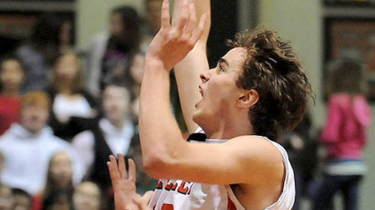 Sewickley Academy's Tom Droney scores against Quigley last night in thier Class A contest. Sewickley Academy won 73-32.