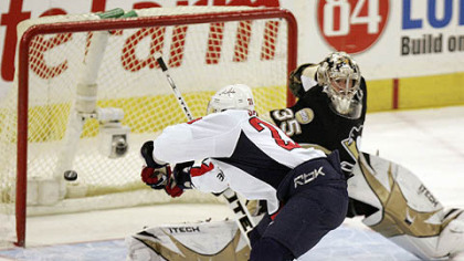 The Capitals' Alexander Semin shoots the puck past Penguins goalie Ty Conklin in the shootout to give the Capitals a 6-5 win last night.