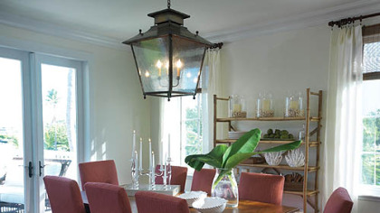In the dining room of the HGTV Dream Home, a lantern lights the table instead of the usual chandelier.