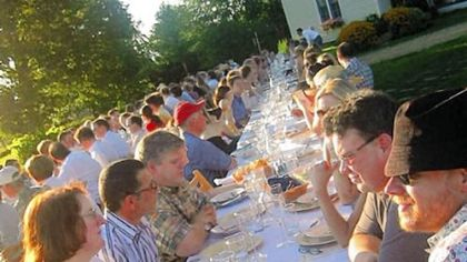 Diners crowd the long table at Outstanding in the Field's dinner at Kinnikinnick Farm in Caledonia, Ill., last Aug. 25.