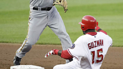 Washington Nationals Cristian Guzman (15) is forced out at second by Pittsburgh Pirates Freddy Sanchez, left, during the first inning of an MLB baseball game, Thursday in Washington. Nationals Ryan Zimmerman (not shown) was safe at first on the play.