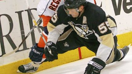 Defenseman Sergei Gonchar battles for the puck with the Islanders' Steve Regier in the Penguins' 3-1 win March 27 at Mellon Arena. The defense has developed into a reliable group as it prepares for next week's playoffs.