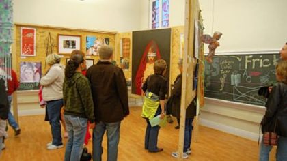 Visitors look at artwork in the Catalyst Building during last year's Art All Night Lawrenceville.
