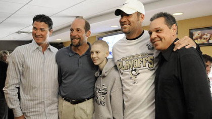 John Challis poses for a photo with Penguins owner Mario Lemieux, Atlanta Braves pitcher John Smoltz, Steelers quarterback Ben Roethlisberger and ex-Penguins star Pierre Larouche during the Penguins game against the Flyers on May 11.