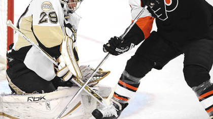 Marc-Andre Fleury makes one of his 17 saves.