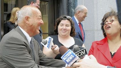 Former Allegheny County Coroner Dr. Cyril H. Wecht, left, jokes with reporters after arguments about whether Dr. Wecht should be retried were made before the 3rd U.S. Circuit Court of Appeals.