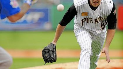 Zach Duke comes off the mound to field a bunt by Chicago's Henry Blanco in the seventh inning yesterday at PNC Park.