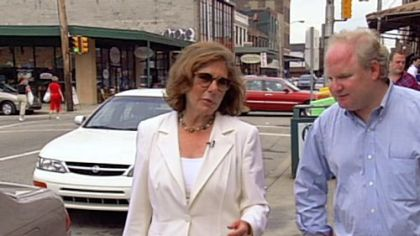 "Teresa Heinz Kerry and Carl Kurlander stroll the Strip District in ""My Tale of Two Cities,"" Kurlander's film about his return to his hometown."