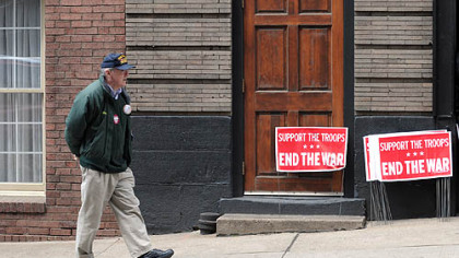 Marty O'Malley, a Forest Hills council member and Vietnam veteran, paces outside the Downtown office of U.S. Rep. Mike Doyle on Thursday.  He was waiting for an anti-war petition that he planned to present to the congressman's office, but the person with it did not show.