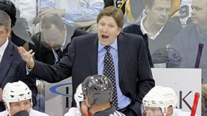 Red Wings coach Mike Babcock, top, appeals to referee Paul Devorski in the first period of Game 3 of the Stanley Cup final Wednesday at Mellon Arena.