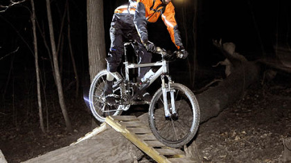 Jared Musser, 26, a civil engineer, pedals over a ramp on the Nature Trail in Frick Park. He began night riding in 2002, when he bought his first headlight.