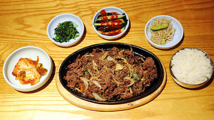 Bulgogi, thinly sliced beef marinated in light soy sauce, is a specialty of the house at the Korea Garden in Oakand.