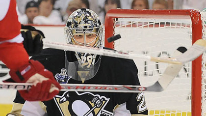 Penguins goalie Marc-Andre Fleury makes save on Red Wings Johan Franzen in the second period of Game 3 at the Mellon Arena. His performance tonight may prove crucial to the Penguins' prospects.