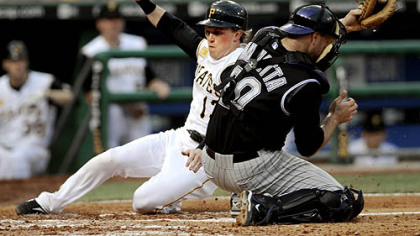 Nate McLouth begins the Pirates' rally, scoring in the third inning.