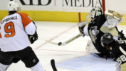 Penguins Marc-Andre Fleury makes a save on Flyers Scottie Upshall late in the third period Sunday.