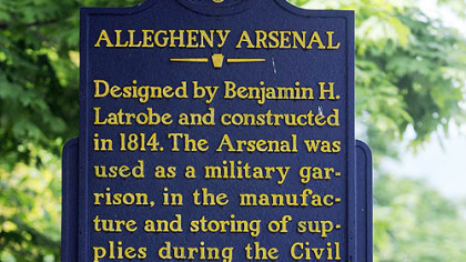 Allegheny Arsenal Historical Marker with the Arsenal Park in the background in Lawrenceville.