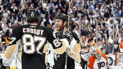 Penguins Ryan Malone celebrates with Sidney Crosby after Crosby scores in the first period.