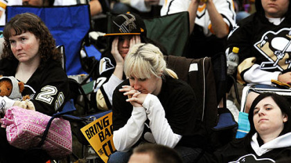 Erin Kolenda, center, and other Penguins fans feel the pain.