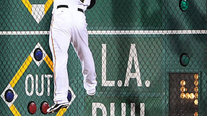 Right fielder Jason Michaels tries to make a leaping catch at the wall on a ball hit by the Cubs' Derrek Lee last night.
