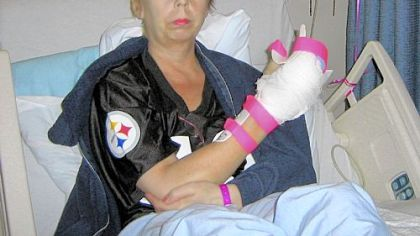 Patricia &quot;Trish&quot; Boyle shows her injured hand.