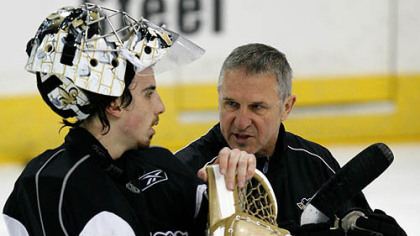 Penguins goalie Marc-Andre Fleury, left, talks with coach Gilles Meloche during the hockey team's practice yesterday at the Mellon Arena in preparation for tonight's game.