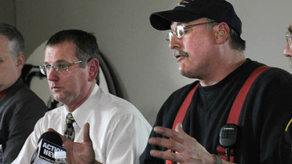 Brockway Mayor William Hrinia, left, and Fire Chief Chris Benson discuss the fatal fire in which 10 people died.