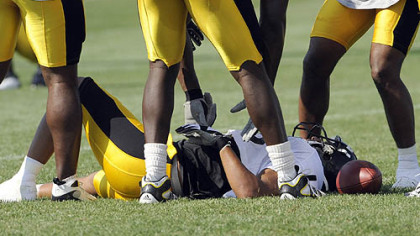 Hines Ward is slow to get up after taking a hard hit from teammate Anthony Smith.