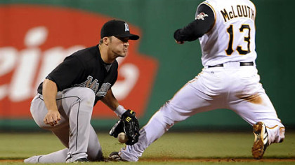 Nate McLouth is caught stealing at second base by the Marlins' Dan Uggla in the sixth inning.
