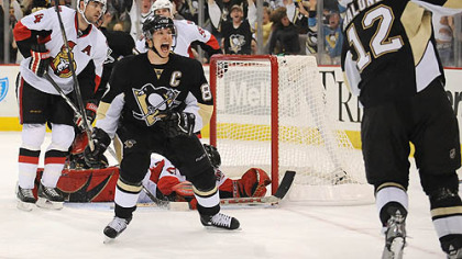 The Penguins' Sidney Crosby celebrates game winning goal by Ryan Malone in the third period against the resurgent Senators in Game Two last night at Mellon Arena.