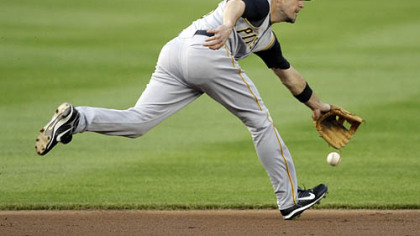 Pittsburgh Pirates shortstop Chris Gomez misses a grounder hit by Washington Nationals Felipe Lopez during the first inning of an MLB baseball game, Thursday in Washington.