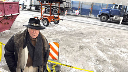 Sol Gross stands in front of his building at 625 Stanwix St., where the street and sidewalks are coated with a layer of dirt from the North Shore Connector light-rail tunnel project.
