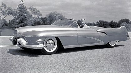Harley Earl in the 1951 one-of-a-kind Le Sabre convertible that he designed.