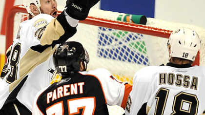 Adam Hall knocks the puck away from the Flyers' Ryan Parent.