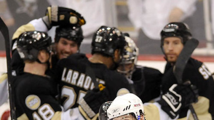 A dejected Rangers Jaromir Jagr leaves the ice as the Penguins celebrates their 5-4 victory.