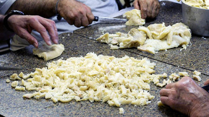 Preparation for the monthly tripe dinner at the Italian Club in Muse includes cutting up tripe after it is cooked. It will be served in marinara sauce prepared by the club's ladies auxiliary. The club has been serving tripe for more than 50 years.