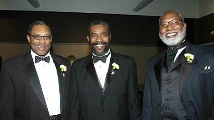 Former Steelers Dwight White, Joe Green, and L.C. Greenwood share a moment at the Steelers 75th Gala event at the David L. Lawrence Convention Center in 2007