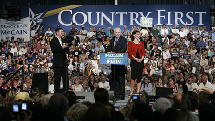 Republican presidential candidate Sen., John McCain, R-Ariz., center, and his vice presidential running mate, Alaska Gov. Sarah Palin, right, with her husband Todd Palin, left, address supporters during a campaign rally at Franklin & Marshall College in Lancaster yesterday.
