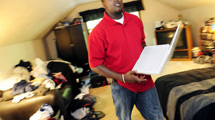 Laptop in hand, Bobby Franklin moves about his room at this parent&#039;s home in Plum.  A recent graduate of Clarion, Mr. Franklin says his dream job would be in pharmaceutical sales.