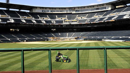 The outfield of PNC Park get trimmed up as the ballpark is whipped into shape for the home opener on Monday.
