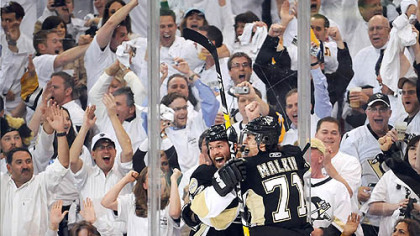 The Penguins&#039; Ryan Malone celebrates Evgeni Malkin&#039;s goal against the Flyers at the Mellon Arena last night.