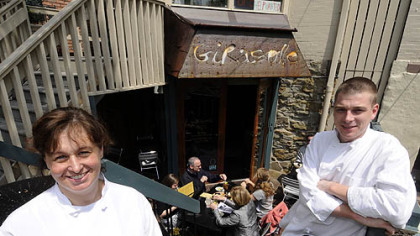 Girasole's executive chef Jennifer Girasole, left, and head chef Chris Corimski sit at the restaurant's entrance and outside dining area in Shadyside.