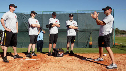 New pitching coach Jeff Andrews, right, works with some of his pitchers yesterday on the first morning of minicamp at Pirates City in Bradenton, Fla.