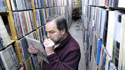 Paul Mawhinney examines a Rolling Stones album he said is worth  $10,000 at Record Rama in Ross.