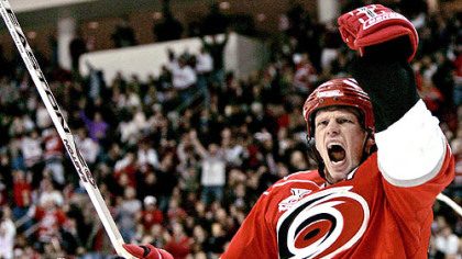 The Hurricanes' Eric Staal celebrates his goal with Jeff Hamilton in the second period against the Penguins last night in Raleigh, N.C. Staal is the older brother of Penguins center Jordan Staal.