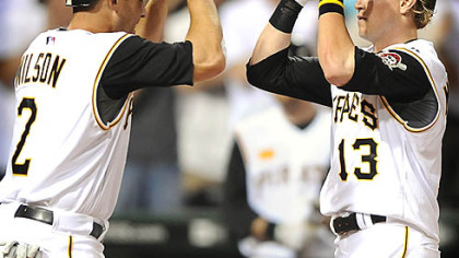 Pirates Nate McLouth is greeted at home by Jack Wilson after hitting a game-winning two run homer against the Yankees in the 7th inning at PNC Park last night.