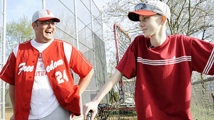 Freedom's John Challis talks with head coach Steve Wetzel after a game April 24.
