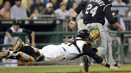 Pirates catcher Ryan Doumit stretches out to tag out Colorado's Ian Stewart near third base to end the sixth inning last night at PNC Park.