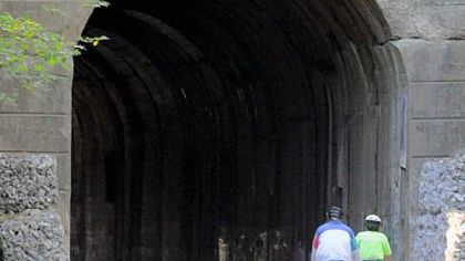 Cyclists cruise into the Greers Tunnel along the Montour Trail in Peters.