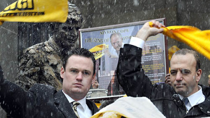 Pittsburgh Mayor Luke Ravenstahl, left, and Allegheny County Chief Executive Dan Onorato wave their Terrible Towels in  honor of Myron Cope at a rally at the City-County Building today.